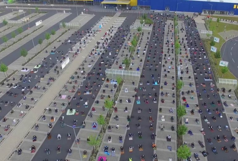 Extraordinary moment Muslims gather in Ikea car park to celebrate Eid while social distancing