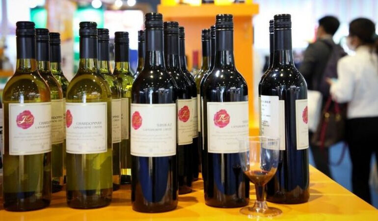 China slaps up to 200% tariffs on Australian wine - BBC
