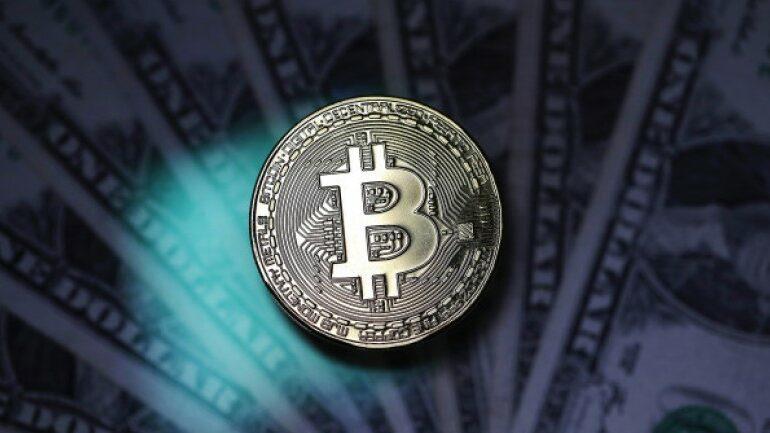 Bitcoin's market value tops $1 trillion